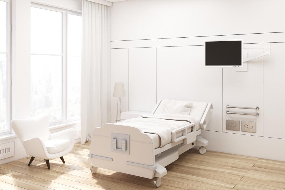 pokój szpitalny z łózkiem rehabilitacyjnym